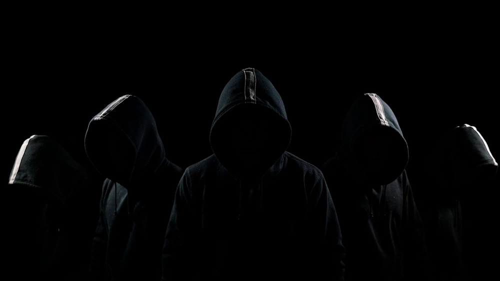 videoblocks-five-mysterious-hooded-men-standing-in-the-dark-hoodies-and-hidden-faces_hzcvnekb0x_thumbnail-full01.thumb.png.80a137178f72475ed1b2a45fc78cb957.png