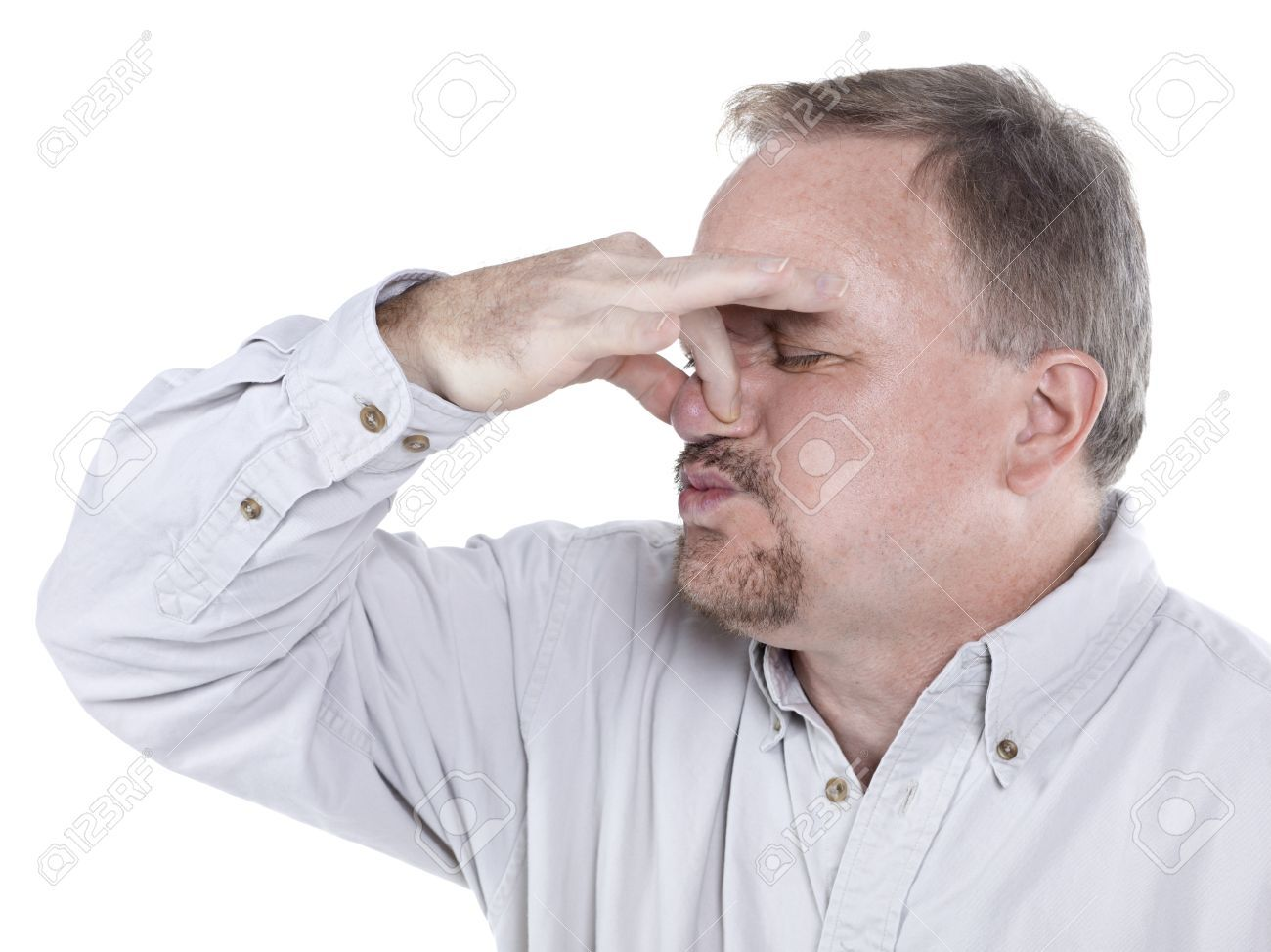 16993040-portrait-of-an-old-man-holding-his-nose-tight-to-plug-out-the-horrible-smell.jpg.b51218c298a948acef12fac908b5fb7e.jpg